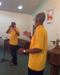Deaf members Nathaniel Wright and Carroll Young signing a duet