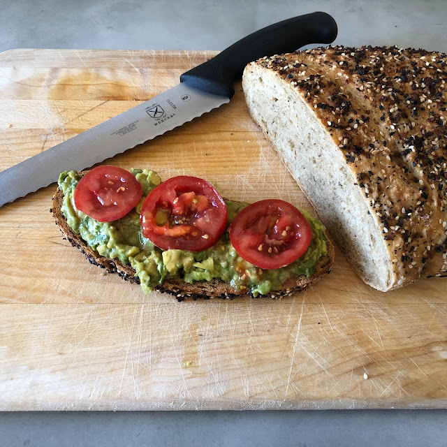 Avocado toast with tomatoes and my favorite bread knife