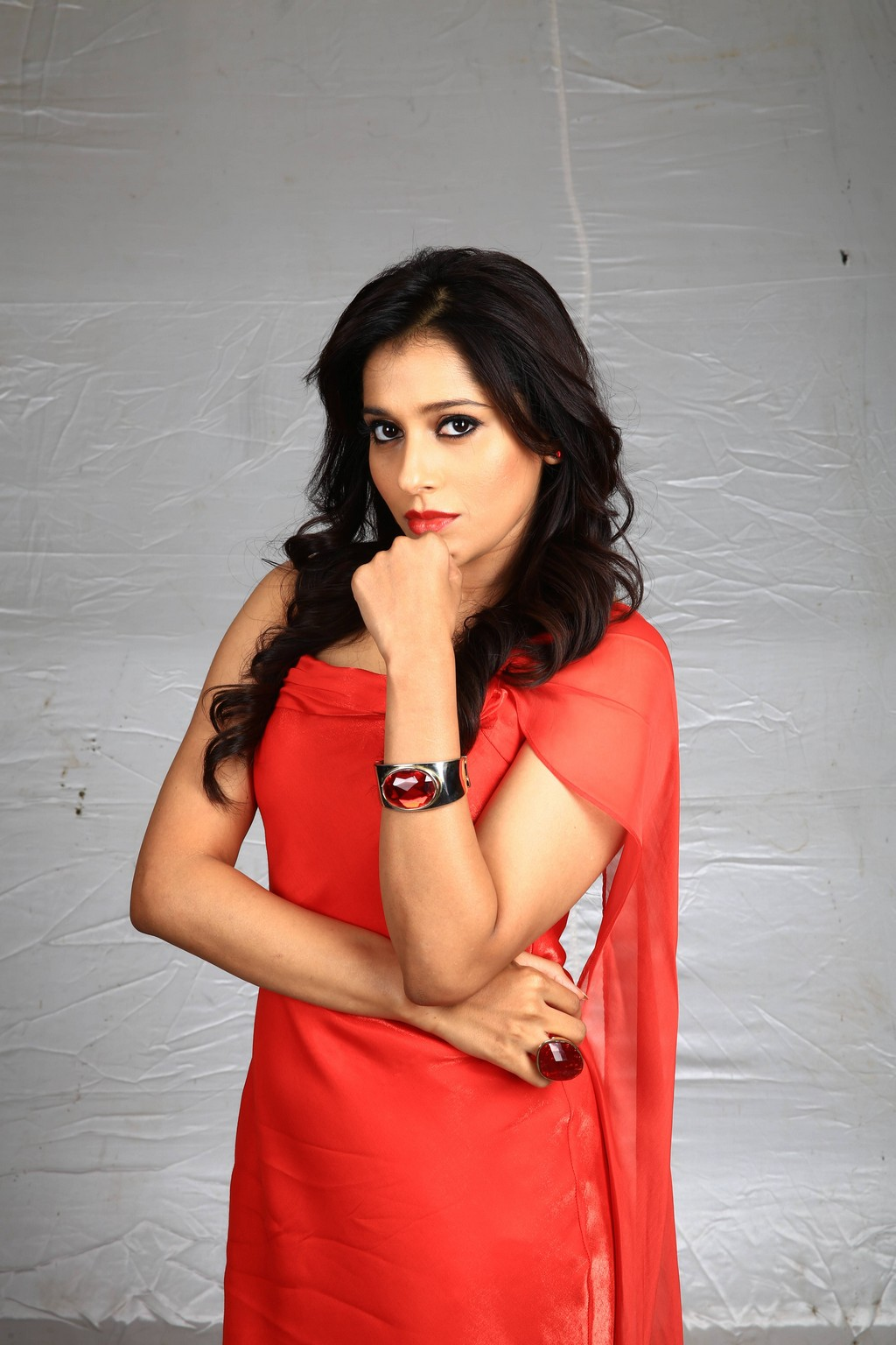 Telugu TV Anchor Rashmi Gautam Long Hair Hot Looking Face Photos In Orange Dress