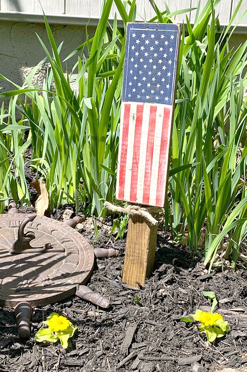 Rustic painted American flag in the garden