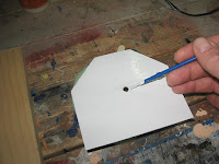 Paint one side of the plywood clock face white,
