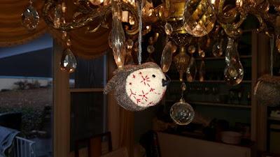 felt Indian robin on chandelier