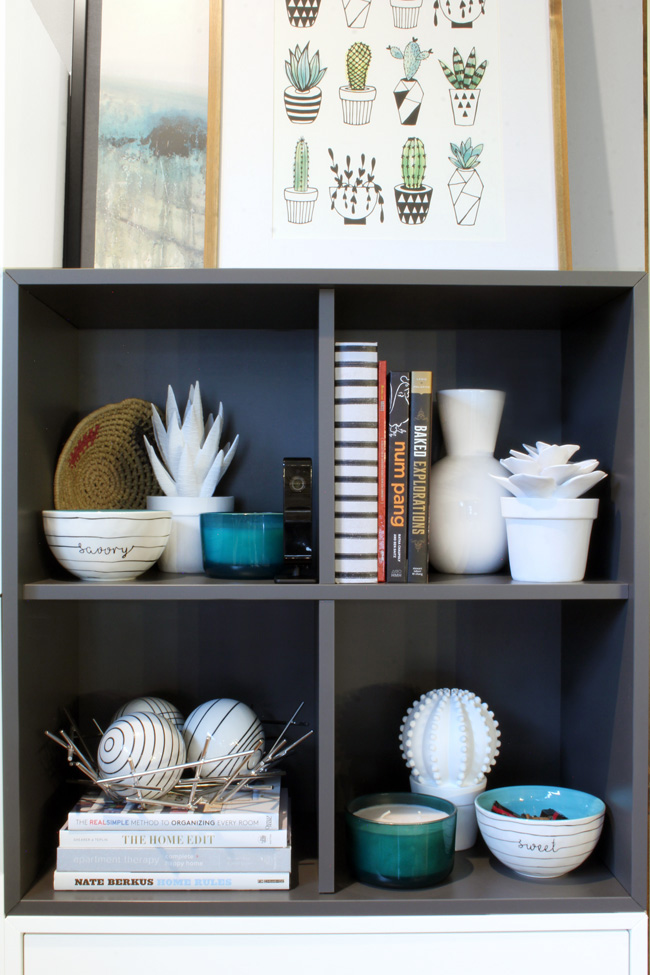Discreet security camera on styled open kitchen shelving