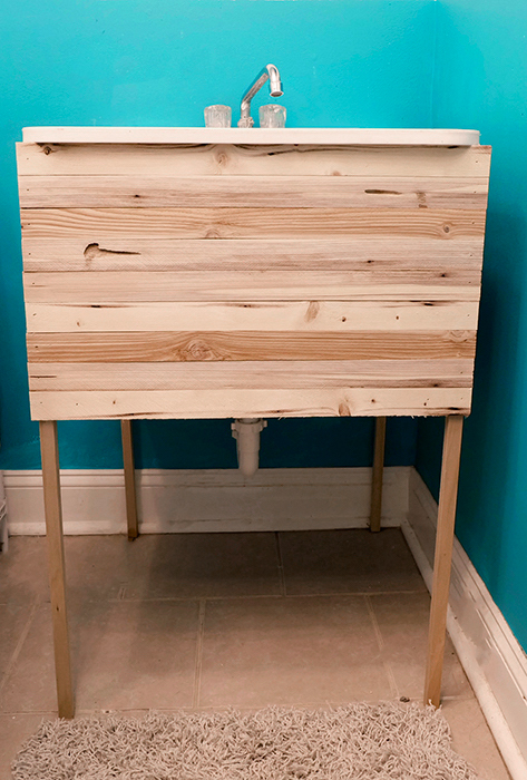 hidden laundry sink by wood lath and wood dowels