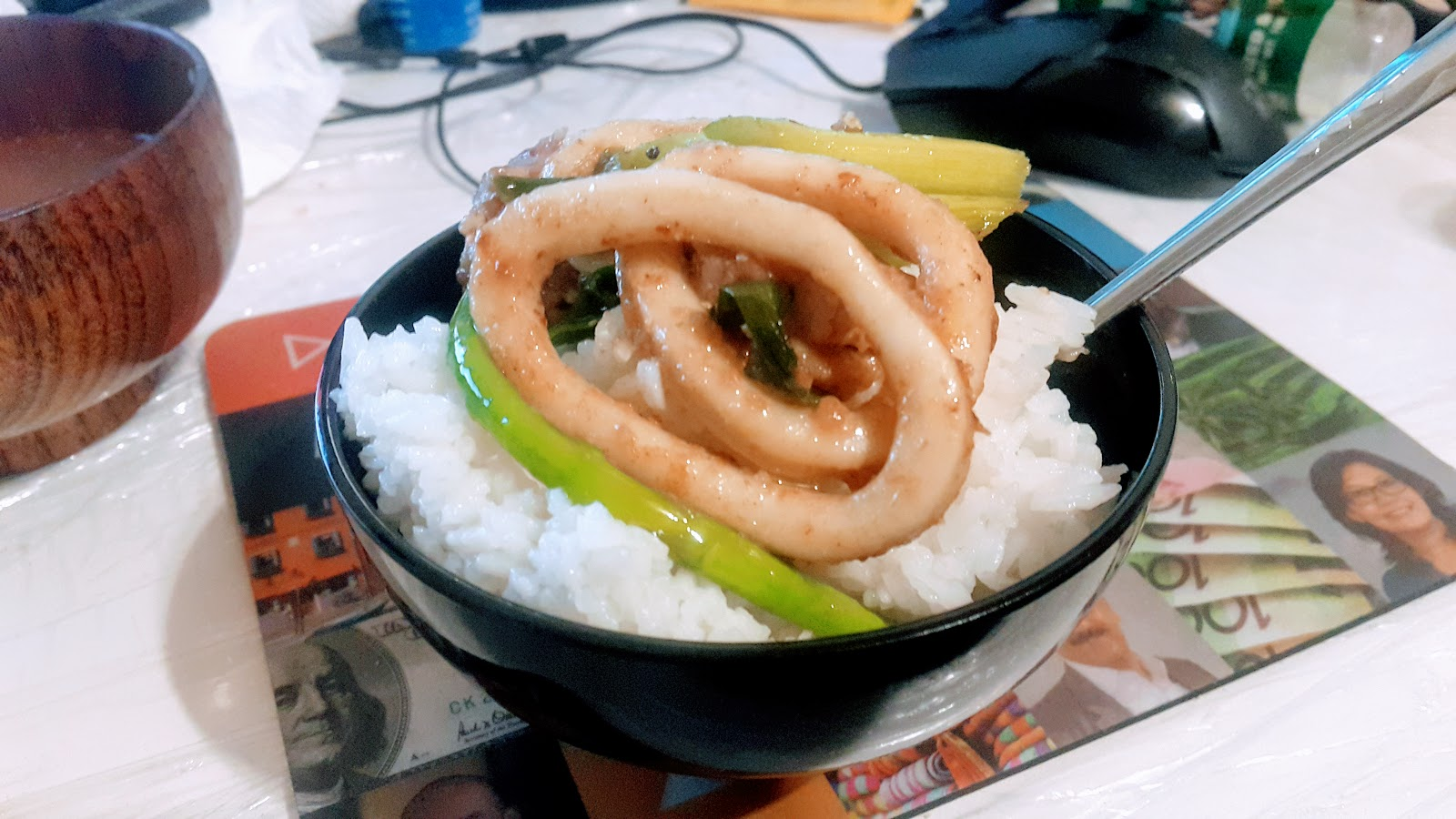 Calamari stir fry asparagus with rice in Japanese cup