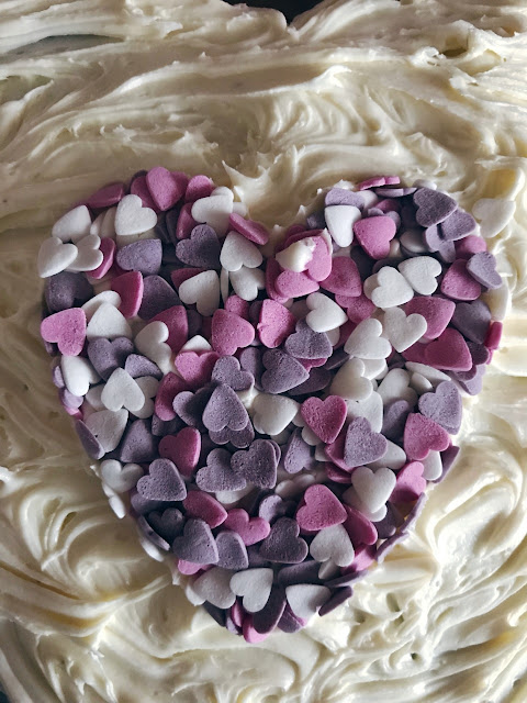 cutter removed leaving a heart shape in the centre of the cake