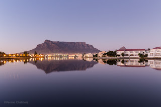 Copyright Vernon Chalmers: Before sunrise: Table Mountain / Cape Town over Milnerton Lagoon