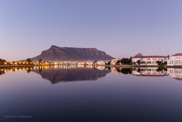 Copyright Vernon Chalmers: Before sunrise: Table Mountain / Cape Town over Milnerton Lagoon