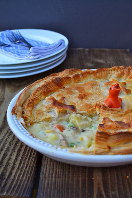 Cheesy Vegetable Puff Pie in a pie dish with a pastry bird to let out steam