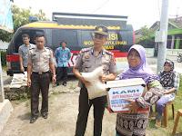 Satgas Nusantara Polres Tanggamus Berikan Bahan Pokok dan Kesehatan Gratis di Kota Agung Barat