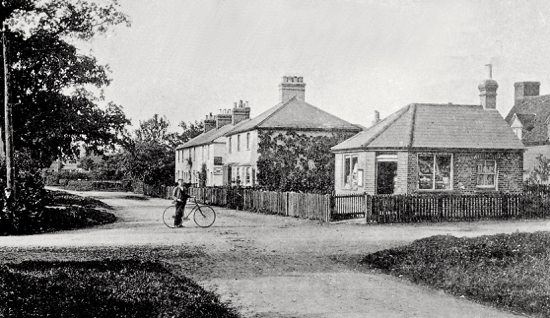 A photograph from a postcard of the cross roads at White's Corner, Welham Green c1900. Photo by George. J. Knott
