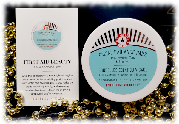 First Aid Beauty Facial Radiance Pads jar & description card