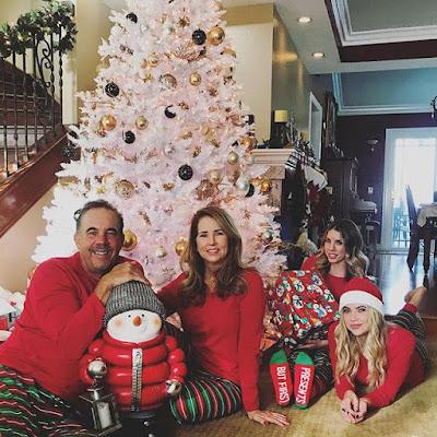 Ashley Benson, sister Shaylene Benson, mother Shannon Harte, father Benson in front of white Christmas tree