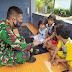 Keakraban Satgas TMMD 109 dengan Anak Kecil Bagaikan Anak Kami