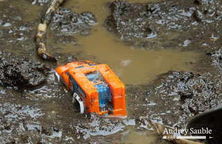 a toy truck in mud