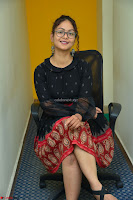 Aditi Myakal in Spicy Red Short Skirt and Transparent Black Top at at Big FM For Promotion of Movie Ami Tumi 011.JPG