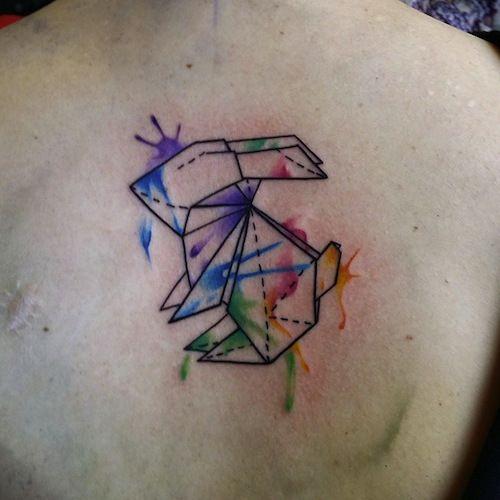 tatuaje de conejo origami en acuarela