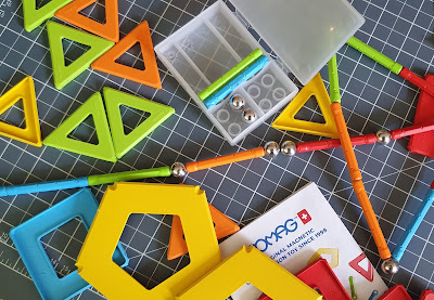 Lots of Geomag magnetic toy on the table strewn about