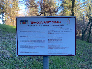 "Traccia Partigiana or ""trail of the partisans"" sign lists the partisans."