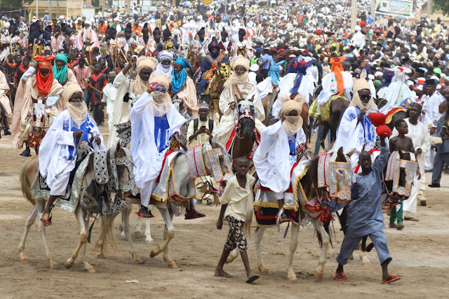 saluting the Emir with a handkerchief