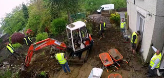 A digger is needed for the garden