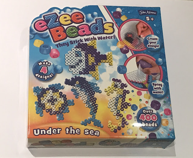 A box of eZee beads by John Adams showing the designs you can make in the Under The Sea set of a turtle, a dolphin, a seahorse and a fish