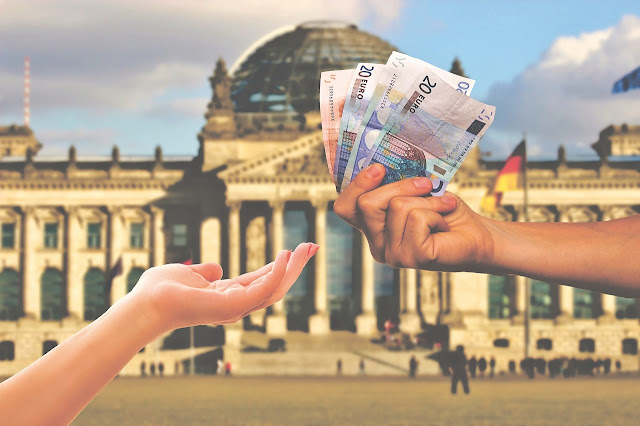 Pengertian Uang dan Fungsi Uang