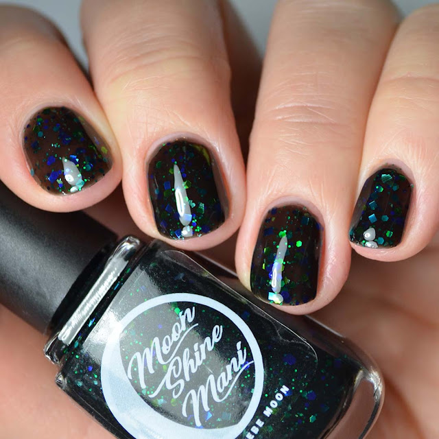 black jelly nail polish with black and green glitter swatch