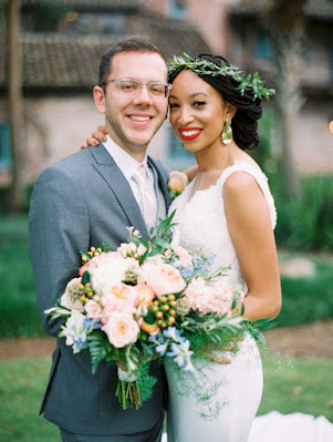 groom and bride with bouquet and flower crown