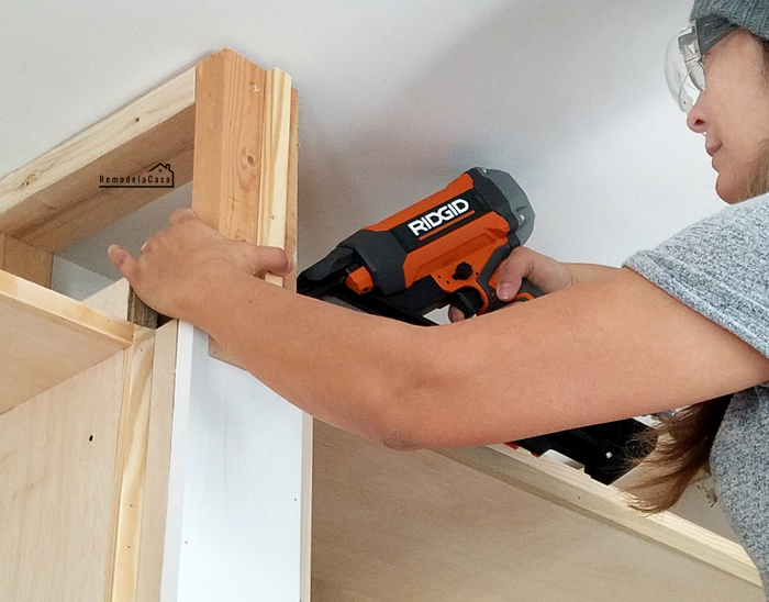 Cristina Garay building with Ridgid angles finish nailer