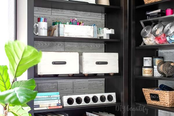 wood painted drawer adds stylish storage to bookshelves