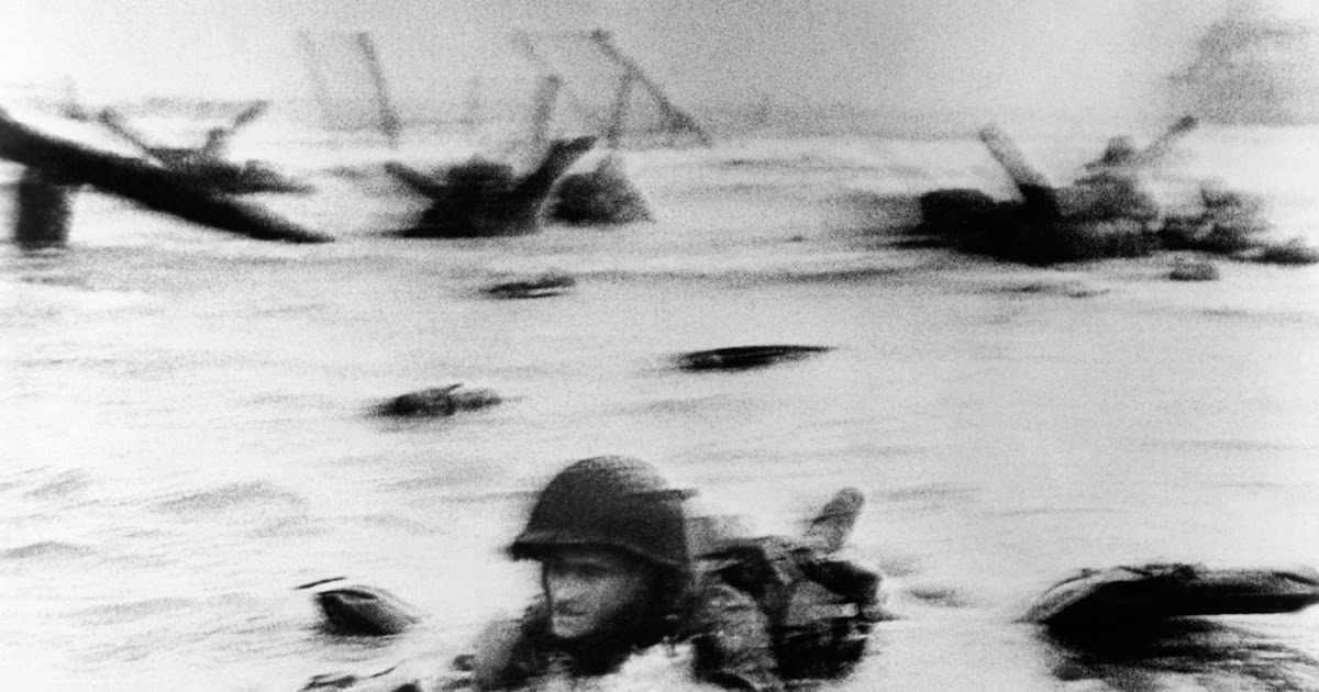 Soldier taking cover at Omaha Beach on D-Day, June 6th 1944