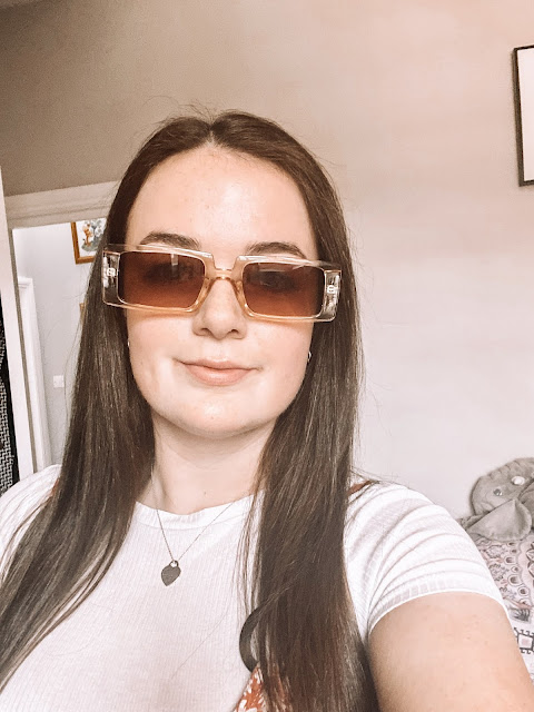 girl in bedroom with shein sunglasses