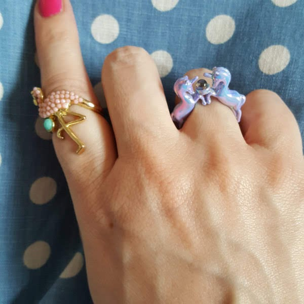 unicorn ring and flamingo ring on hand