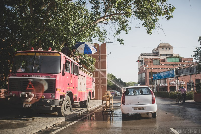 Took this Street Photography Shot on 21-May-2020 of The Fire and Rescue Personnel's Who Were Disinfecting Vehicles at the Ajmeri Gate, Jaipur.