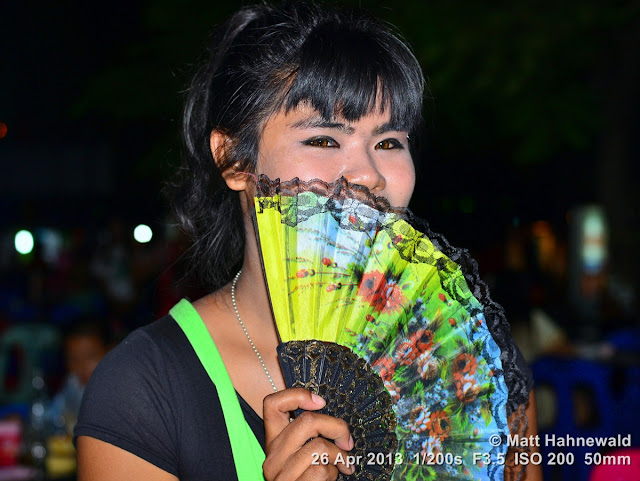 © Matt Hahnewald, Facing the World, people, street portrait, closeup, night, Asia, Thailand, Prachuap Khiri Khan, sexual ambiguity, beautiful, ambiguous, genderqueer, posing, hand-held fan, transgender