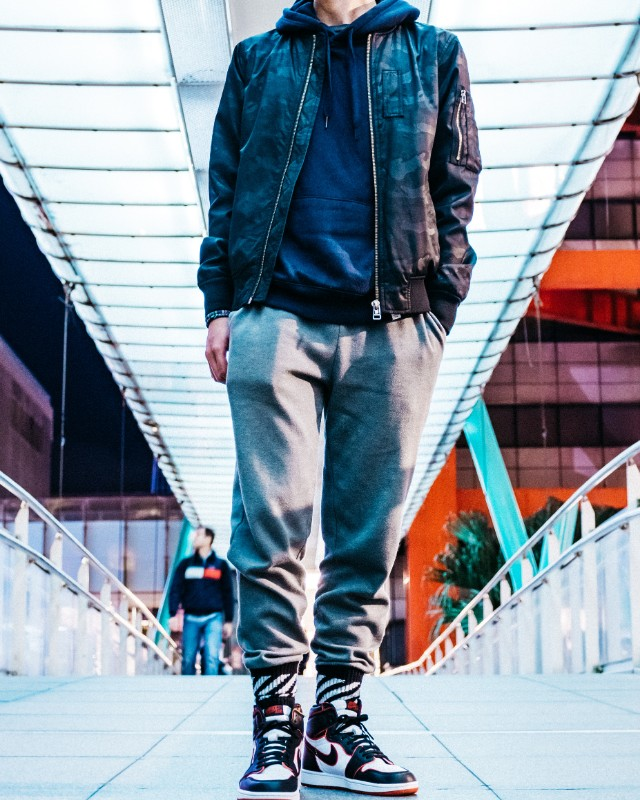 Bomber jacket over hoodie and joggers.