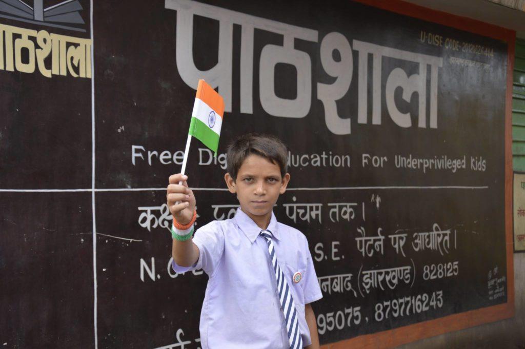 school boy with flag