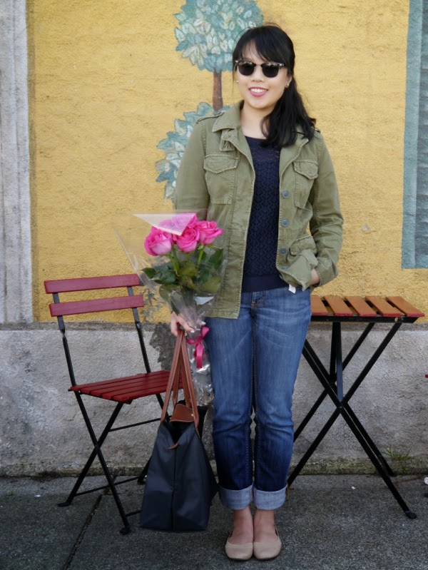 Casual military jacket worn with a navy sweater, boyfriend jeans, Ray-Ban Clubmaster style sunglasses, nude flats, and a large Longchamp Le Pliage grey tote