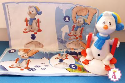 Новогодние игрушки Kinder Maxi лыжник снеговик с вкладышем