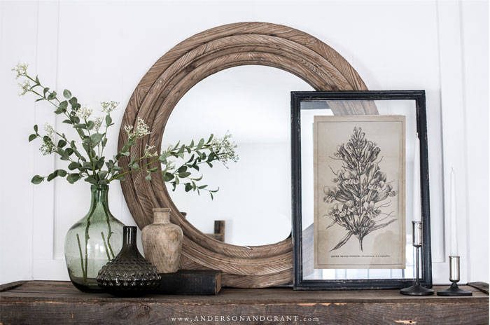 Mantel filled with farmhouse style decor