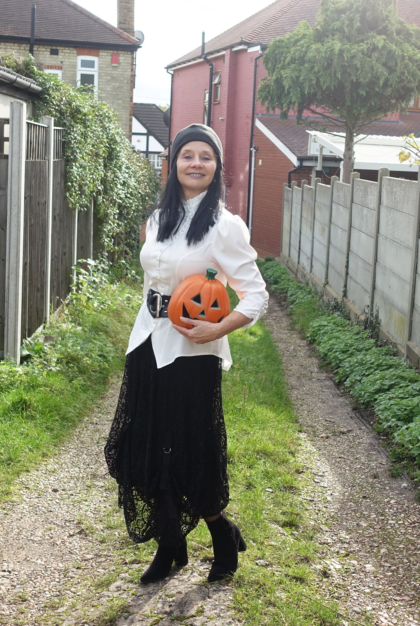 With Halloween approaching Is This Mutton's Gail Hanlon attempts to style Gothic Romance with a white pearl buttoned blouse, black lace skirt, black wig and black ankle boots