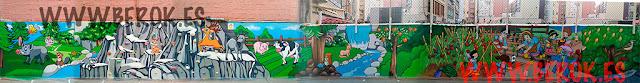 Pintura mural infantil realizada a mano en patio de Colegio