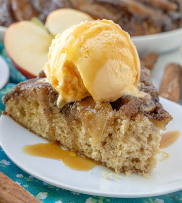 slice of caramel apple skillet cake with bite missing from the end