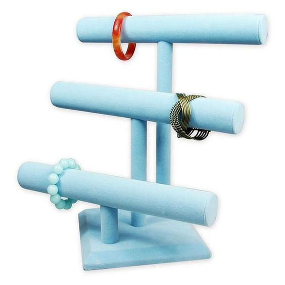A light blue T-bar jewelry display in velvet.