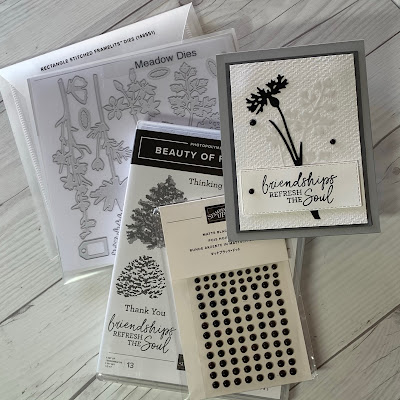 Craft tools used to create gray and white floral handmade friendship card