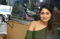 Pragya Jaiswal in a single Sleeves Off Shoulder Green Top Black Leggings promoting JJN Movie at Radio City 10.08.2017 041.JPG