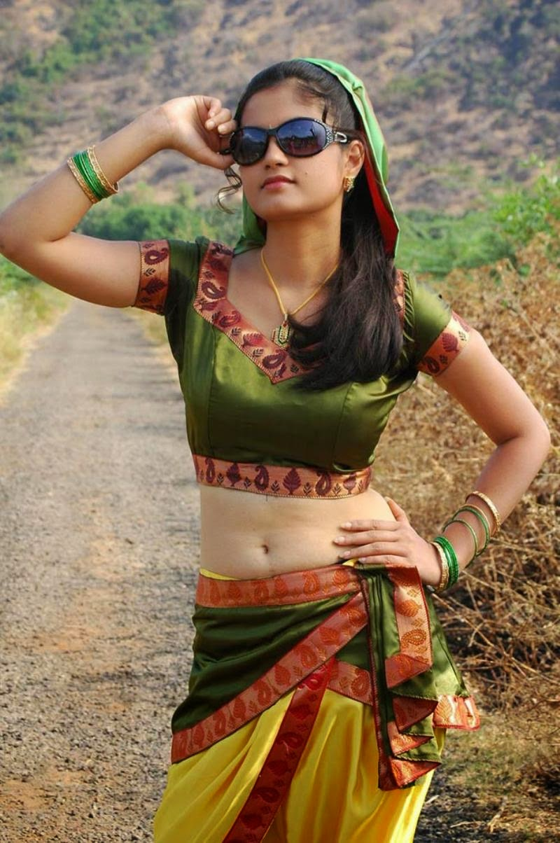 Madhulika hot stills in blouse with navel show
