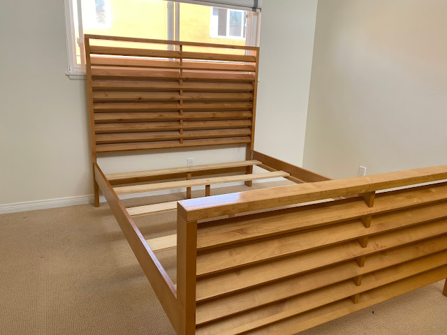 empty bed frame waiting for naturepedic mattress