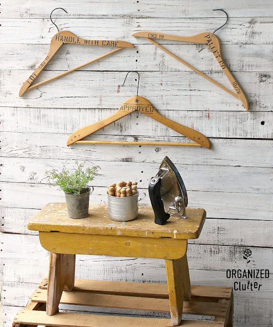 Stenciled Wooden Clothes Hanger Wall Decor #oldsignstencils #stencil #laundryroomdecor #repurposed #clotheshangers #woodhangers